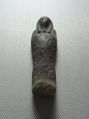<em>Ushabti of Yuf-o</em>, 664-343 B.C.E. Faience, 3 1/4 x 1 x 1/2 in. (8.3 x 2.5 x 1.3 cm). Brooklyn Museum, Charles Edwin Wilbour Fund, 37.241E. Creative Commons-BY (Photo: Brooklyn Museum, CUR.37.241E_view11.jpg)