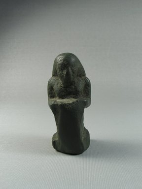 <em>Small Figure of a Man Kneeling and Holding Tablet Before Him</em>. Schist, 37.251E: 3 x 1 5/16 x 1 3/8 in. (7.6 x 3.4 x 3.5 cm). Brooklyn Museum, Charles Edwin Wilbour Fund, 37.251E. Creative Commons-BY (Photo: Brooklyn Museum, CUR.37.251E_view01.jpg)