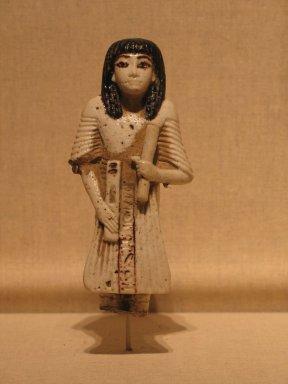 <em>Statue of Hori Represented as a Scribe</em>, ca. 1295-1185 B.C.E. Faience, 5 1/4 x 2 5/8 x 1 3/16 in. (13.3 x 6.6 x 3 cm). Brooklyn Museum, Charles Edwin Wilbour Fund, 37.257E. Creative Commons-BY (Photo: Brooklyn Museum, CUR.37.257E_wwg8.jpg)