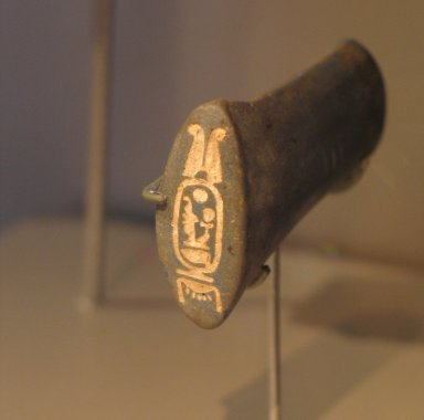 <em>Handle of Model Ax Inscribed for Amunhotep III</em>, ca. 1390–1352 B.C.E. Lapis lazuli, 1 15/16 x 1 3/8 in. (4.9 x 3.5 cm). Brooklyn Museum, Charles Edwin Wilbour Fund, 37.280E. Creative Commons-BY (Photo: Brooklyn Museum, CUR.37.280E_erg456.jpg)
