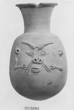 <em>Vase with Face of Bes on One Side</em>, 664-332 B.C.E. Clay, 6 3/8 x Diam. 3 15/16 in. (16.2 x 10 cm). Brooklyn Museum, Charles Edwin Wilbour Fund, 37.328E. Creative Commons-BY (Photo: Brooklyn Museum, CUR.37.328E_NegD_print_bw.jpg)