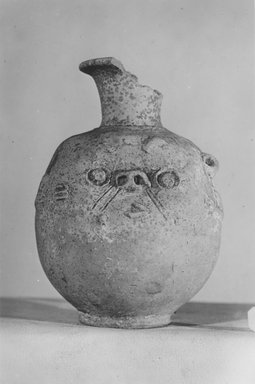<em>Vase with Face of Bes on One Side</em>. Clay, 4 13/16 x Diam. 2 3/8 in. (12.2 x 6 cm). Brooklyn Museum, Charles Edwin Wilbour Fund, 37.329E. Creative Commons-BY (Photo: Brooklyn Museum, CUR.37.329E_NegC_print_bw.jpg)