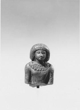 <em>Fragmentary Statuette of a Man</em>, ca. 1479-1390 B.C.E. Faience, 2 1/8 × 1 1/2 × 7/8 in. (5.4 × 3.8 × 2.2 cm). Brooklyn Museum, Charles Edwin Wilbour Fund, 37.334E. Creative Commons-BY (Photo: Brooklyn Museum, CUR.37.334E_NegA_print_bw.jpg)