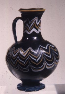 <em>Polychrome Core-formed Bottle with Festooned Design</em>, ca. 1390-1336 B.C.E. Glass, 3 3/8 x Diam. 2 7/16 in. (8.6 x 6.2 cm). Brooklyn Museum, Charles Edwin Wilbour Fund, 37.341E. Creative Commons-BY (Photo: Brooklyn Museum, CUR.37.341E_view1.jpg)