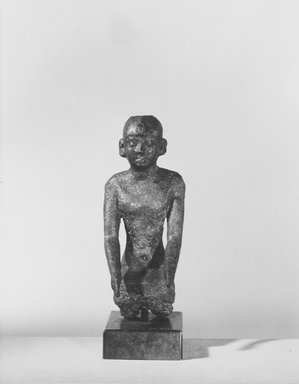 <em>Small Figurine of a Kneeling Man</em>. Bronze, 4 x 1 5/8 x 2 1/4 in. (10.2 x 4.1 x 5.7 cm). Brooklyn Museum, Charles Edwin Wilbour Fund, 37.361E. Creative Commons-BY (Photo: Brooklyn Museum, CUR.37.361E_NegA_print_bw.jpg)