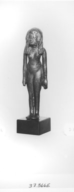 <em>Figurine of a Girl</em>. Bronze, 3 11/16 x 1 1/8 x 11/16 in. (9.3 x 2.8 x 1.8 cm). Brooklyn Museum, Charles Edwin Wilbour Fund, 37.366E. Creative Commons-BY (Photo: Brooklyn Museum, CUR.37.366E_NegID_37.552E_GRPA_print_cropped_bw.jpg)
