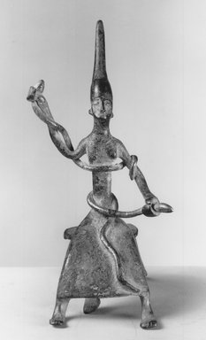 Dahomey. <em>Female Figure with Snakes</em>, late 19th century. Copper alloy, gilt, height (including tripod): 5 1/2 in.  (13.9 cm). Brooklyn Museum, A. Augustus Healy Fund, 37.366. Creative Commons-BY (Photo: Brooklyn Museum, CUR.37.366_print_front_bw.jpg)