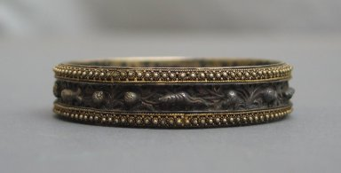 <em>Pair of Bracelets</em>. Silver gilt, .2: 9/16 x 2 11/16 in. (1.5 x 6.8 cm). Brooklyn Museum, Frank L. Babbott Fund, 37.371.130.1-.2. Creative Commons-BY (Photo: Brooklyn Museum, CUR.37.371.130.2_side.jpg)