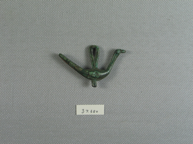 Greek. <em>Geometric Bird</em>, late 8th or early 7th century B.C.E. Bronze, 1 7/16 x 2 5/8 x 3/8 in. (3.6 x 6.6 x 1 cm). Brooklyn Museum, Museum Collection Fund, 37.380. Creative Commons-BY (Photo: Brooklyn Museum, CUR.37.380_view01.jpg)