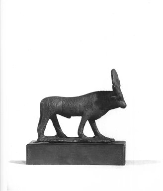 <em>Small Hathor Cow</em>, 305-30 B.C.E. Bronze, 1 15/16 x 11/16 x 2 5/16 in. (4.9 x 1.8 x 5.8 cm). Brooklyn Museum, Charles Edwin Wilbour Fund, 37.384E. Creative Commons-BY (Photo: Brooklyn Museum, CUR.37.384E_NegA_print_bw.jpg)