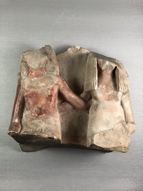 <em>Fragmentary Group of a Man and Wife Seated</em>, ca. 1390-1352 B.C.E. Limestone, pigment, 10 5/8 × 10 7/16 × 4 3/4 in. (27 × 26.5 × 12 cm). Brooklyn Museum, Charles Edwin Wilbour Fund, 37.393E. Creative Commons-BY (Photo: , CUR.37.393E_view01.jpg)
