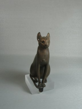 <em>Statue of a Cat</em>, 305-30 B.C.E. Bronze, with tang: 4 13/16 x 1 13/16 x 2 7/8 in. (12.3 x 4.6 x 7.3 cm). Brooklyn Museum, Charles Edwin Wilbour Fund, 37.426E. Creative Commons-BY (Photo: Brooklyn Museum, CUR.37.426E_view1.jpg)