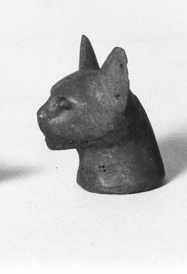<em>Separate Head of a Cat Probably from a Small Sarcophagus</em>, 305-30 B.C.E. Bronze, 2 1/2 x 1 11/16 x 1 15/16 in. (6.3 x 4.3 x 4.9 cm). Brooklyn Museum, Charles Edwin Wilbour Fund, 37.428E. Creative Commons-BY (Photo: Brooklyn Museum, CUR.37.428E_neg_37.426E_grpA_bw.jpg)