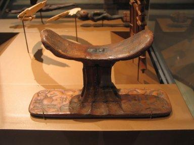 <em>Headrest with Birth Gods on Base and Neck Support</em>, ca. 1390-1292 B.C.E. Wood, 5 11/16 x 10 1/16 in. (14.5 x 25.5 cm). Brooklyn Museum, Charles Edwin Wilbour Fund, 37.434E. Creative Commons-BY (Photo: Brooklyn Museum, CUR.37.434E_erg456.jpg)