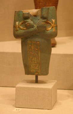 <em>Funerary Figurine of Akhenaten</em>, ca. 1352-1336 B.C.E. Faience, 4 13/16 x width at elbows 2 13/16 in. (12.3 x 7.2 cm). Brooklyn Museum, Charles Edwin Wilbour Fund, 37.503. Creative Commons-BY (Photo: Brooklyn Museum, CUR.37.503_wwgA-3.jpg)