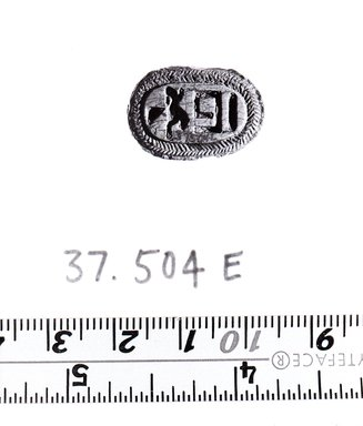 <em>Scarab Seal of Taharka</em>. Steatite, glaze, 3/8 x 9/16 x 13/16 in. (1 x 1.4 x 2.1 cm). Brooklyn Museum, Charles Edwin Wilbour Fund, 37.504E. Creative Commons-BY (Photo: Brooklyn Museum, CUR.37.504e_negA_bw.jpg)