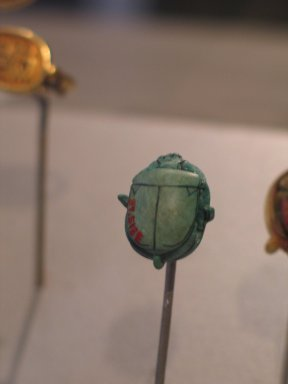 <em>Scarab of Thutmose III</em>, ca. 1479-1425 B.C.E., or later. Steatite, glaze, 5/16 x 9/16 x 11/16 in. (0.9 x 1.4 x 1.8 cm). Brooklyn Museum, Charles Edwin Wilbour Fund, 37.513E. Creative Commons-BY (Photo: Brooklyn Museum, CUR.37.513E_erg456.jpg)