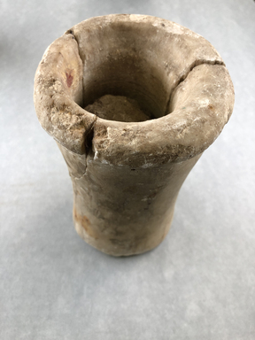 <em>Cylindrical Jar with Ball of Clay Inside</em>, ca. 2675-2170 B.C.E. Egyptian alabaster (calcite), clay, 6 5/8 × Diam. 3 3/4 in. (16.8 × 9.5 cm) . Brooklyn Museum, Charles Edwin Wilbour Fund, 37.53E. Creative Commons-BY (Photo: , CUR.37.53E_view01.jpg)