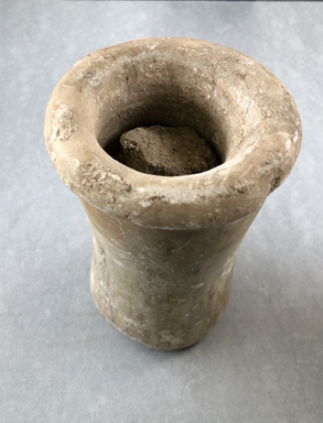 <em>Cylindrical Jar with Ball of Clay Inside</em>, ca. 2675-2170 B.C.E. Egyptian alabaster (calcite), clay, 6 7/16 × Diam. 3 3/4 in. (16.3 × 9.6 cm). Brooklyn Museum, Charles Edwin Wilbour Fund, 37.54E. Creative Commons-BY (Photo: , CUR.37.54E_view01.jpg)