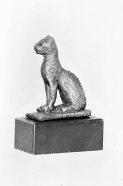 <em>Small Statuette of a Cat</em>, 664-525 B.C.E., or 305-30 B.C.E. Bronze, 1 3/4 x 3/4 x 1 3/8 in. (4.4 x 2 x 3.5 cm). Brooklyn Museum, Charles Edwin Wilbour Fund, 37.551E. Creative Commons-BY (Photo: Brooklyn Museum, CUR.37.551E_NegID_37.551E_GRPA_cropped_bw.jpg)