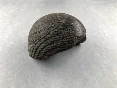 <em>Part of a Wig from a Composite Statue</em>, ca. 1352-1336 B.C.E. Granite, 3 3/4 × 3 7/8 × 2 1/8 in. (9.5 × 9.8 × 5.4 cm). Brooklyn Museum, Charles Edwin Wilbour Fund, 37.561. Creative Commons-BY (Photo: , CUR.37.561_view01.jpg)