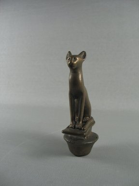 <em>Top of Ceremonial Staff in the Form of the Papyrus Umbel Surmounted by a Cat</em>, ca. 1539-1075 B.C.E. or later. Bronze, 4 3/16 x 5 1/8 in. (10.6 x 13 cm). Brooklyn Museum, Charles Edwin Wilbour Fund, 37.574E. Creative Commons-BY (Photo: Brooklyn Museum, CUR.37.574E_View1.jpg)