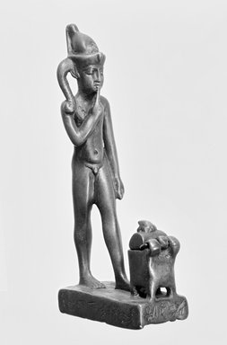 <em>Figure of the Child Horus Standing in Front of a Small Box with Moveable Cover</em>, 664-332 B.C.E. Bronze, 5 1/8 x 1 1/8 x 2 3/8 in. (13 x 2.8 x 6.1 cm). Brooklyn Museum, Charles Edwin Wilbour Fund, 37.593E. Creative Commons-BY (Photo: Brooklyn Museum, CUR.37.593E_NegD_print_bw.jpg)