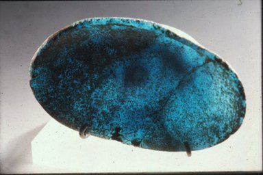 <em>Dish in Form of Seashell</em>, ca. 1390-1292 B.C.E. Glass, 7/8 x 2 5/8 x 4 5/8 in. (2.2 x 6.6 x 11.7 cm). Brooklyn Museum, Charles Edwin Wilbour Fund, 37.599E. Creative Commons-BY (Photo: Brooklyn Museum, CUR.37.599E_view1.jpg)