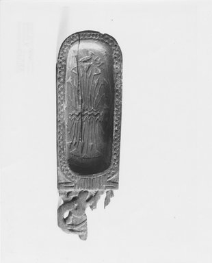 <em>Toilet Spoon in the Form of a Cartouche</em>, ca. 1539-1292 B.C.E. Wood, pigment, 9/16 x 1 15/16 x 6 1/4 in. (1.4 x 5 x 15.9 cm). Brooklyn Museum, Charles Edwin Wilbour Fund, 37.614E. Creative Commons-BY (Photo: Brooklyn Museum, CUR.37.614E_NegA_print_bw.jpg)