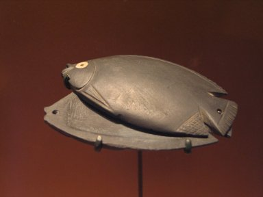 <em>Cosmetic Dish in the Form of a Fish</em>, ca. 3000-2800 B.C.E. Graywacke, inlay of shell and black paste, 3 1/4 x 1 3/4 in. (8.3 x 4.4 cm). Brooklyn Museum, Charles Edwin Wilbour Fund, 37.629Ea-b. Creative Commons-BY (Photo: Brooklyn Museum, CUR.37.629Ea-b_erg3.jpg)