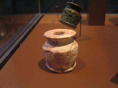 <em>Breccia Kohl Pot</em>, ca. 1539-1478 B.C.E. Breccia, 2 3/8 x 2 3/8 in. (6 x 6.1 cm). Brooklyn Museum, Charles Edwin Wilbour Fund, 37.643E. Creative Commons-BY (Photo: Brooklyn Museum, CUR.37.643E_erg2.jpg)