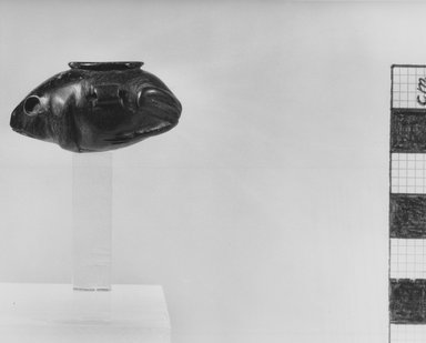 <em>Ointment Jar in the Form of a Frog</em>, ca. 4400-2675 B.C.E. Serpentine, 13/16 x 1 1/2 in. (2.1 x 3.8 cm). Brooklyn Museum, Charles Edwin Wilbour Fund, 37.648E. Creative Commons-BY (Photo: Brooklyn Museum, CUR.37.648E_NegH_print_bw.jpg)