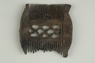 Coptic. <em>Comb</em>, 5th-7th century C.E. Wood, 3 7/16 x 3 3/8 in. (8.7 x 8.6 cm). Brooklyn Museum, Charles Edwin Wilbour Fund, 37.672E. Creative Commons-BY (Photo: Brooklyn Museum (in collaboration with Index of Christian Art, Princeton University), CUR.37.672E_ICA.jpg)