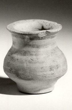 Indus Valley Culture. <em>Miniature Jar</em>, 3000-2500 B.C.E. Reddish pottery, 1 3/4 x 1 9/16 in. (4.4 x 4 cm). Brooklyn Museum, A. Augustus Healy Fund, 37.67. Creative Commons-BY (Photo: Brooklyn Museum, CUR.37.67_bw.jpg)
