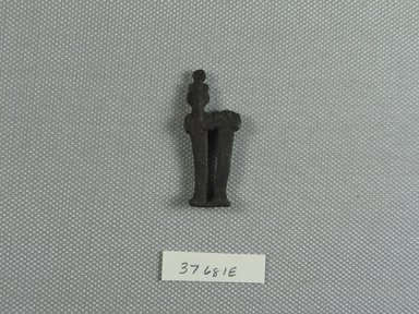 <em>Small Double Statuette of Osiris on a Common Base</em>. Bronze, 1 5/8 x 11/16 x 3/16 in. (4.2 x 1.7 x 0.5 cm). Brooklyn Museum, Charles Edwin Wilbour Fund, 37.681E. Creative Commons-BY (Photo: Brooklyn Museum, CUR.37.681E_view01.jpg)