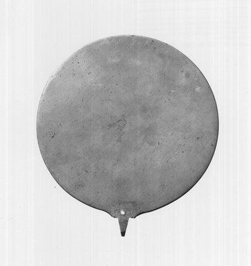 <em>Mirror without Handle</em>. Bronze Brooklyn Museum, Charles Edwin Wilbour Fund, 37.696E. Creative Commons-BY (Photo: Brooklyn Museum, CUR.37.696E_print_negA_bw.jpg)