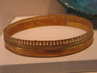 <em>Circlet</em>, ca. 1295-1070 B.C.E. Gold, 1 1/8 × 1/16 × 6 9/16 in., 1.1 lb. (2.8 × 0.2 × 16.6 cm, 0.5kg). Brooklyn Museum, Charles Edwin Wilbour Fund, 37.702E. Creative Commons-BY (Photo: Brooklyn Museum, CUR.37.702E_wwgA-1.jpg)