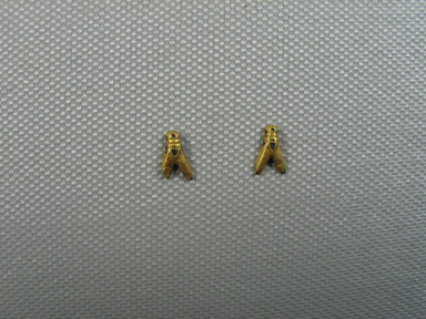 <em>Small Bead in Form of a Fly</em>. Gold, 3/16 x 1/16 x 3/8 in. (0.5 x 0.1 x 0.9 cm). Brooklyn Museum, Charles Edwin Wilbour Fund, 37.704E. Creative Commons-BY (Photo: , CUR.37.704E_37.705E_view01.jpg)