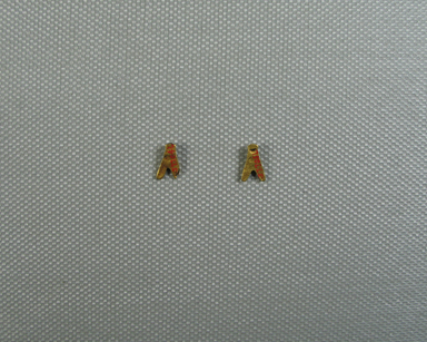 <em>Small Bead in Form of a Fly</em>, ca. 1539-1292 B.C.E. Gold, 3/16 x 1/16 x 3/8 in. (0.5 x 0.1 x 0.9 cm). Brooklyn Museum, Charles Edwin Wilbour Fund, 37.704E. Creative Commons-BY (Photo: , CUR.37.704E_37.705E_view04.jpg)