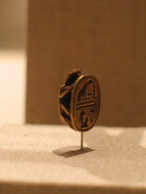 <em>Scarab of the Lady Mutnodjmet</em>, ca. 1336-1327 B.C.E. Gold, 3/8 x 1/2 x 11/16 in. (0.9 x 1.2 x 1.7 cm). Brooklyn Museum, Charles Edwin Wilbour Fund, 37.715E. Creative Commons-BY (Photo: Brooklyn Museum, CUR.37.715E_wwg8.jpg)