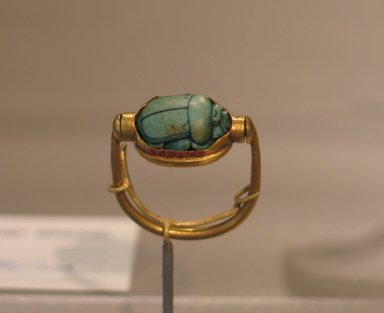 <em>Scarab of Thutmose III Mounted in Ring</em>, ca. 1479-1425 B.C.E. Steatite, glaze, gold, Height 1 1/16 x Length 15/16 in. (2.7 x 2.4 cm). Brooklyn Museum, Charles Edwin Wilbour Fund, 37.720E. Creative Commons-BY (Photo: Brooklyn Museum, CUR.37.720E_erg456.jpg)