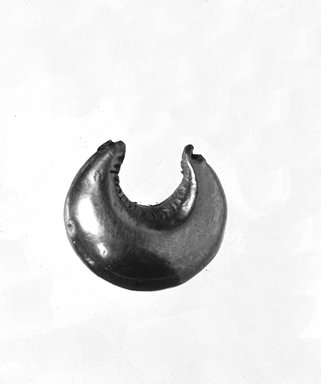 <em>Large Crescent - Shaped Earring</em>, 7th century B.C.E. Gold, 3/4 x 7/16 x 1/2 in. (1.9 x 1.1 x 1.2 cm). Brooklyn Museum, Charles Edwin Wilbour Fund, 37.752E. Creative Commons-BY (Photo: Brooklyn Museum, CUR.37.752E_NegID_37.752E_GRPA_cropped_bw.jpg)
