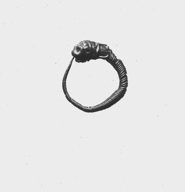 <em>Small Loop Earrings with Lion's Head</em>, late 4th-3rd century B.C.E. Gold, Diameter: 5/8 in. (1.6 cm). Brooklyn Museum, Charles Edwin Wilbour Fund, 37.776E. Creative Commons-BY (Photo: Brooklyn Museum, CUR.37.776E_NegID_37.775E_GRPC_print_cropped_bw.jpg)