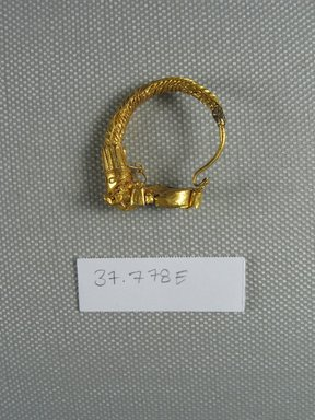<em>Broken Earring with Calf's Head?</em>, late 4th-3rd century B.C.E. Gold, Diam. 9/16 in. (1.5 cm). Brooklyn Museum, Charles Edwin Wilbour Fund, 37.778Ea-b. Creative Commons-BY (Photo: Brooklyn Museum, CUR.37.778Ea-b_overall.jpg)