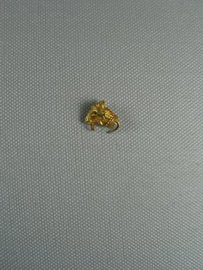 <em>Par of a Earring with Sheep's Head</em>, 3rd century B.C.E. Gold, 9/16 × 9/16 in. (1.4 × 1.5 cm). Brooklyn Museum, Charles Edwin Wilbour Fund, 37.782E. Creative Commons-BY (Photo: Brooklyn Museum, CUR.37.782E_view1.jpg)