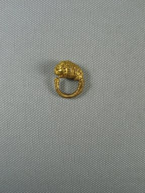 Greek. <em>Ornate Earring with Lion's Head</em>, late 4th-3rd century B.C.E. Gold, Diameter: 7/8 in. (2.3 cm). Brooklyn Museum, Charles Edwin Wilbour Fund, 37.786E. Creative Commons-BY (Photo: Brooklyn Museum, CUR.37.786E_view1.jpg)