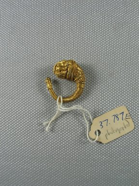 Greek. <em>Ornate Earring with Lion's Head</em>, late 4th-3rd century B.C.E. Gold, Diam. 7/8 in. (2.3 cm). Brooklyn Museum, Charles Edwin Wilbour Fund, 37.787E. Creative Commons-BY (Photo: Brooklyn Museum, CUR.37.787E_overall.jpg)