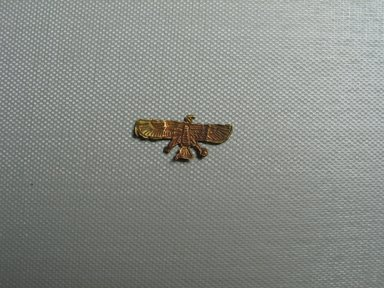 <em>Vulture Amulet</em>, 305-30 B.C.E. Gold, 1/2 x 1/16 x 1 1/8 in. (1.3 x 0.1 x 2.9 cm). Brooklyn Museum, Charles Edwin Wilbour Fund, 37.792E. Creative Commons-BY (Photo: Brooklyn Museum, CUR.37.792E_view01.jpg)
