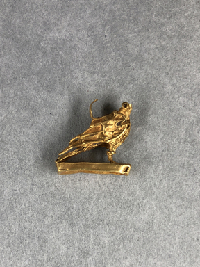 <em>Small Amulet Representing a Falcon</em>, 5th-4th century B.C.E. Gold, 9/16 × 3/16 × 9/16 in. (1.5 × 0.5 × 1.5 cm). Brooklyn Museum, Charles Edwin Wilbour Fund, 37.796E. Creative Commons-BY (Photo: , CUR.37.796E_view01.jpg)