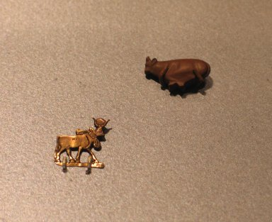 <em>Hathor Cow</em>, ca. 1539-1075 B.C.E. Electrum, 11/16 x 11/16 in. (1.8 x 1.8 cm). Brooklyn Museum, Charles Edwin Wilbour Fund, 37.807E. Creative Commons-BY (Photo: , CUR.37.807E_37.1323E_erg456.jpg)